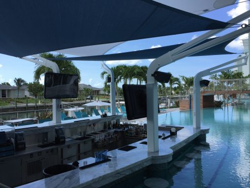 "The ""Lazy River"" pool with swim up bar at the Hilton Resorts World Bimini"