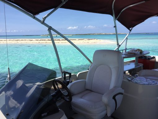 Take a boat out to Honeymoon Harbor to swim with stingrays while staying at Resorts World Bimini in the Bahamas