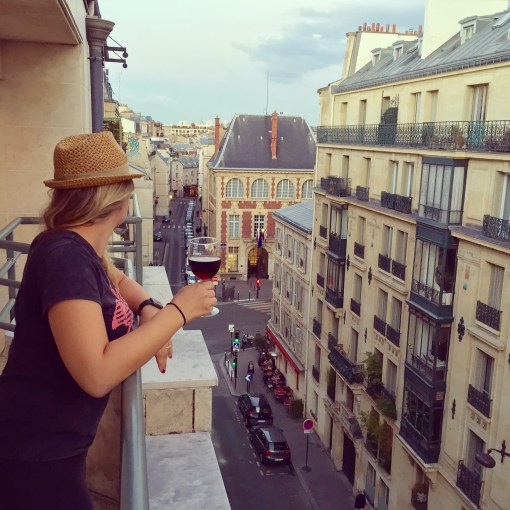 Enjoy a glass of French wine from the private balcony in your own Paris apartment at Villa Daubenton by Happy Culture.
