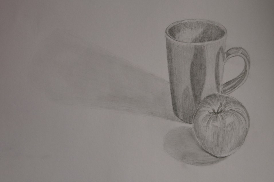 cup and apple with gradations of light