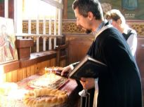 Magura's orthodox church is right at the heart of village life, from cradle to grave