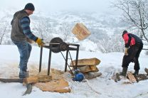 saw, cutting wood, splitting logs, wood-burning stove, Magura, Transylvania