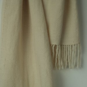 This naturally beautiful scarf has been woven on a handloom and left in its own natural creamy colour without being treated with any dying.Ethically made in india and certified by Craftmark as hand woven and hand-dyed.Made with a blend of super fine wool & merino wool yarns.