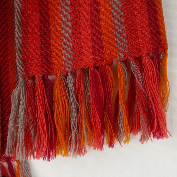 This scarf has been woven on a handloom and dyed using natural plant dyes, sappanwood, harada and tesu giving it its vibrant colours of red, wine and grey.Ethically made in india.Made with a blend of super fine wool & merino wool yarns.