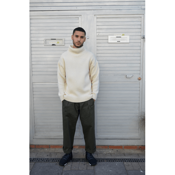 model wearing the Roll neck cream submariner pure merino wool jumper.Inspired by traditional handmade wool jumpers worn by the British seaman, this jumper will keep you warm and comfortable.British made by Mahala is an independent homewares and accessories