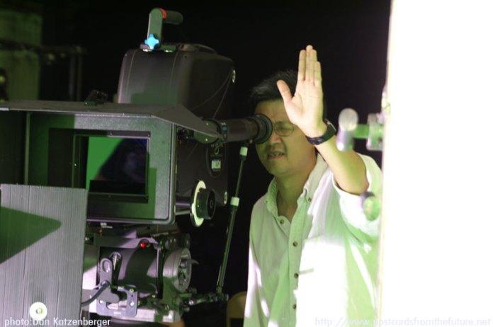 Director Alan Chan blocking out a shot
