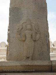 Carving on the manastambha in front of Parshwanath Basadi.
