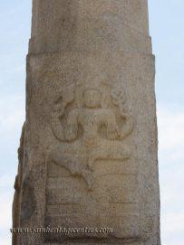 Carving on the manastambha in front of Parshwanath Basadi.