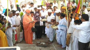 Pooja for carving another row of steps for Vindhyagiri Hillock at Shravanabelagola.