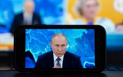 Putin signs law allowing him to run for 2 more terms