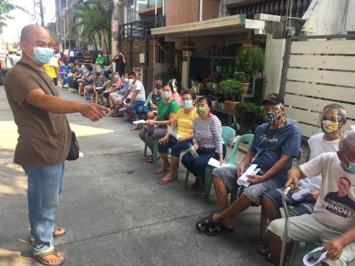 Village chief personally directs cash assistance distribution to sr citizens of Manila