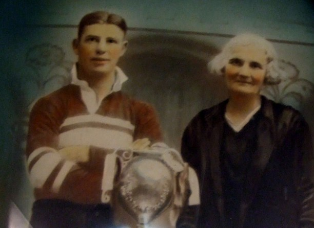 William Arthur (Bill) Pinney of Temora with the Maher Cup and his grandmother Fanny Pinney (1932). Finney later captained the Temora team.