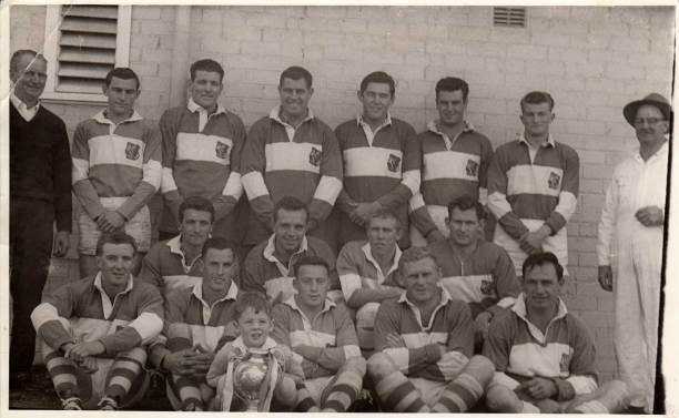 The Cup again in 1965: Back from left - Harold Fuller, Graham Coleman, Gavin Crofton, Gary Lanham, Brian Coleman, Ian Graham, Chris Roberts, with Tom Mooney in the overalls: Middle - Jim Moon, Tom Spain, Peter Faulkner, Pat Wilson: Front - Max Palmer, Jim Taber, John Meale, Alan Ackland and Toby Schofield.