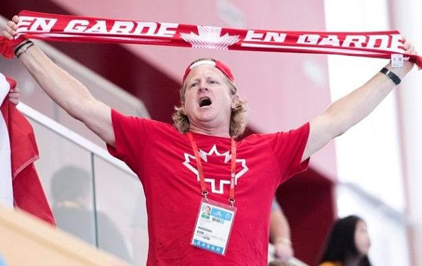 Canada's Pan Am team chief Curt Harnett cheers during a women's water polo match between Canada and Brazil at the Pan Am games in Markham, Ontario, Tuesday, July 7, 2015. (Darren Calabrese/The Canadian Press via AP)