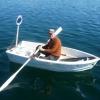 """Luenburgbo i sin roddbåt med fin backspegel i lila med prinsesskrona. Han kallade den """"the princess"""""""