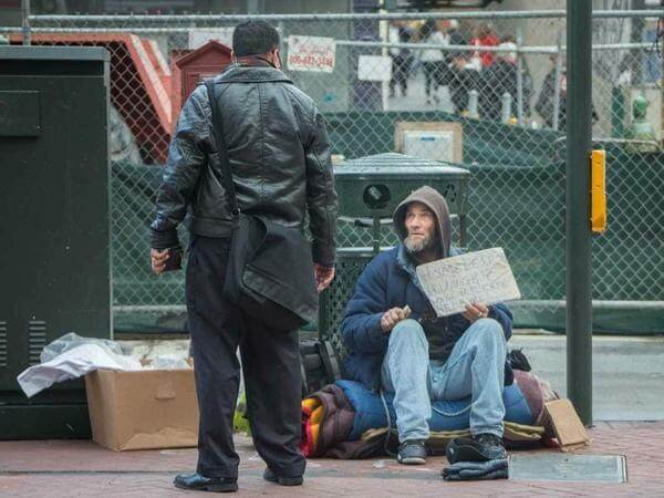 Giving money to homeless people