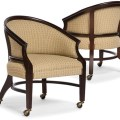 Cream upholstered executive office accent guest chair with casters