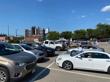 12 vehicle teams lined up in the parking lot next to Tyler History Center.