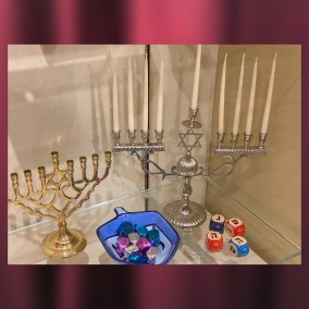 "The Hanukkah celebration, lasting eight days, commemorates the rededication of the Second Temple in Jerusalem in 160 BCE. After the Maccabean Revolt, when the Jewish people reclaimed the Temple and relit its menorah, the menorah stayed lit for eight days even though there was only enough oil to last one night. The dreidel game is played during Hanukkah to remember the suppression of Jewish practices in Judea before the uprising. It also celebrates the Hanukkah miracle – the Hebrew letters marked on the dreidel are an acronym for ""a great miracle happened there.""  This collection of Hanukkah menorahs (hanukkiahs) and dreidels was donated by long-time MVHS Board Member and supporter Marilyn Oyer. Marilyn was an active member of Youngstown's Congregation Rodef Sholom until her passing in 2018.  <br><br>Gift of Marilyn Oyer, 2009.83"