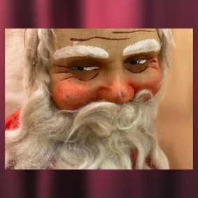 Stuffed Santa Claus with painted cloth face, 1920s  <br><br>Gift of Dr. & Mrs. John Noll, 75.57.15