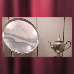 This tray and teapot are part of a service gifted to Vindicator columnist Esther Hamilton. Hamilton held an annual Christmas Show, a fundraiser to benefit Youngstown citizens in need. The Vindicator gave Hamilton this set to mark the Christmas Show's 25th anniversary in 1955.   <br><br>Gift of Ann E. Hamilton, wife of Lte. Wilson S. Hamilton, 2010.63.01