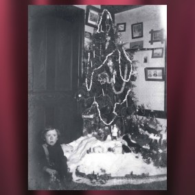 Local photographer Ernest Vickers documented his family's Christmas celebrations in the early 1900s. Here, his son Lindley sits by the Christmas tree. <br><br>Gift of Carl Chuey, 72.71