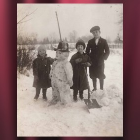 The Megown children build a snowman, c. 1910  <br><br>Gift of Tom Molocea, 2007.78.201