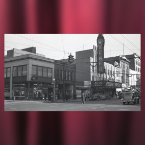 The north side of West Federal Street is decorated with pine roping and lighted stars for the holidays, featuring the Warner Theatre marquis in 1939. <br><br>Gift of David Fithian, 2011.55.95