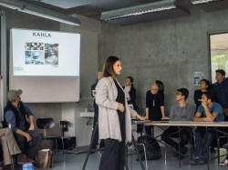 """Ms. Hanne Willmann introducing her excursion class on """"Made in Germany"""": the places where they are visiting to, and the background details"""
