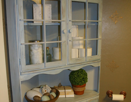 Repurpose Grandma's Hutch and place it in the bathroom