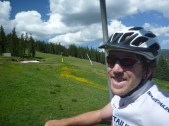 Coworker Russell going up the lift at Copper Mountain with me. We didn't even have to ride our bikes up!