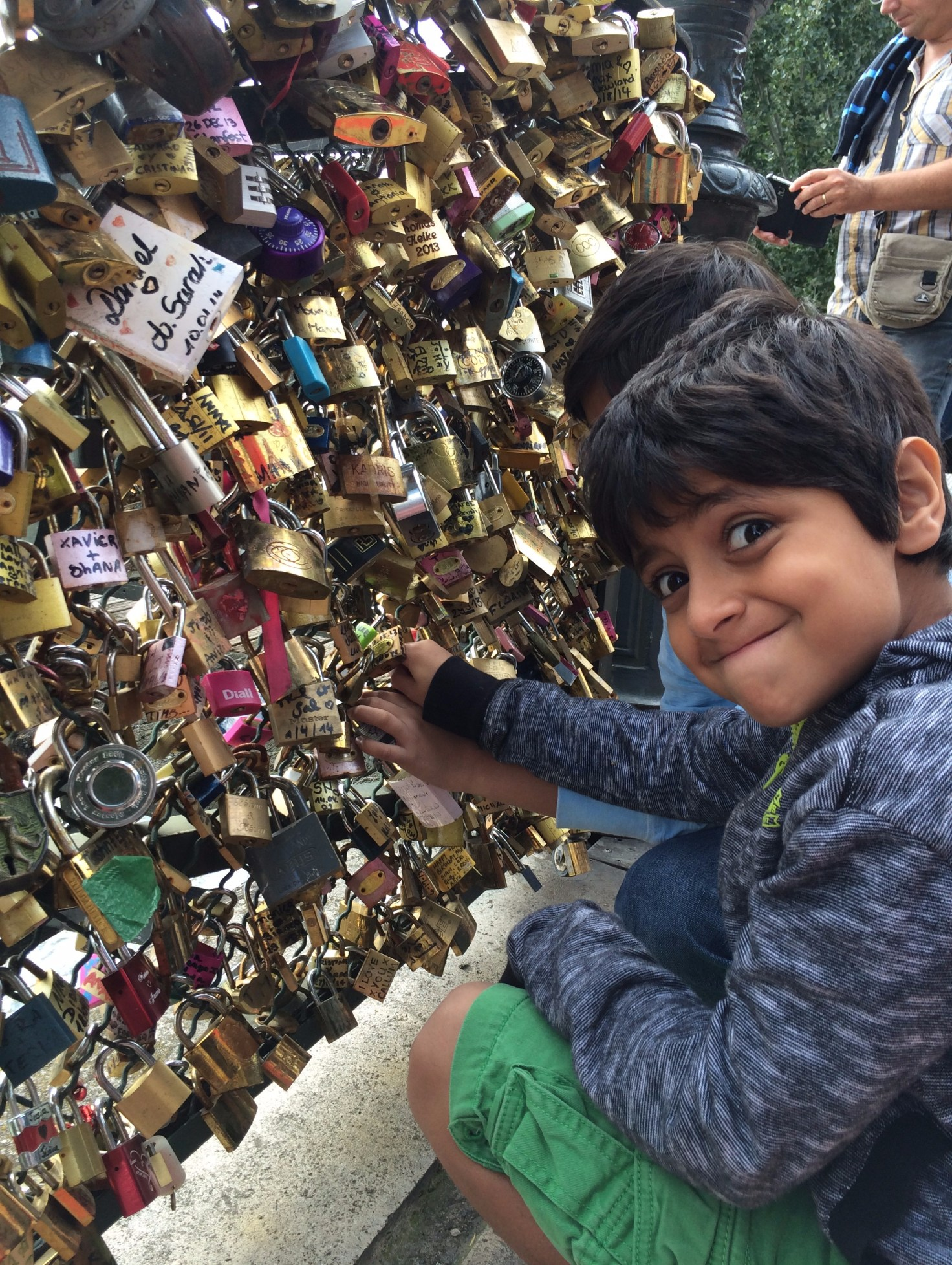 "Child at the ""love locks"" tourist attraction in Paris"