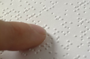 Person reading braille