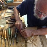 Joe Ascrizzi, carving a rose in the back shop