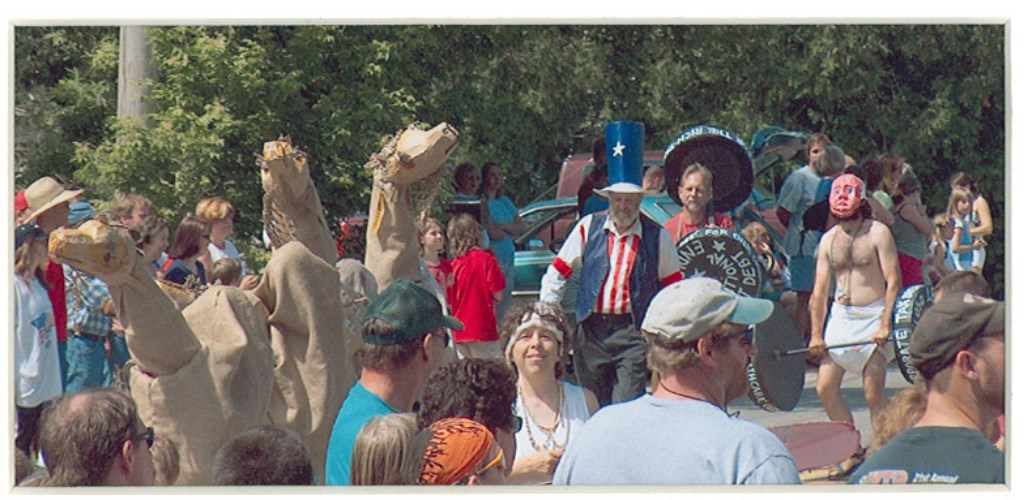 Whitefield Upper Crust Society Thanks Residents for the New Tax Cuts, Whitefield 4th of July 2005 (detail: lifting national debt and camels)