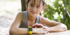 child using GPS watch phone