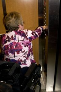 Woman using accessible elevator