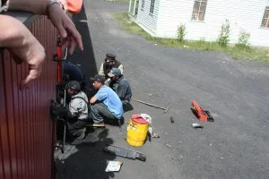 The crew dealing with a hot bearing in the middle of nowhere