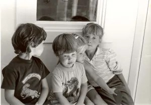 Jake, Max, Lisa and Sara when they were really young, sitting on Grandma Clark's front steps