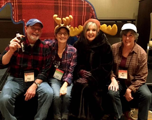 Crime Bake attendees sporting flannel shirts, moose antlers and other Minnesota-ish garb at Saturday evening's banquet. From left, Kent Krueger, Lucy Burdette, Hank Phillippi Ryan and Hallie Ephron