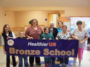 Madison Elementary School staff and students receive the HealthierUS School Challenge Bronze Award.