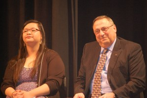 Michelle Zhang, Cony High School senior, takes the stage with Governor LePage.