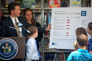 Commissioner Bowen explains A-F school report cards at press conference Wednesday.
