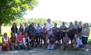 Participants from the 2012 Summer Teacher's Institute pose with a pony.