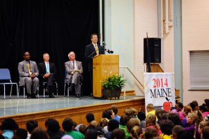 Commissioner Bowen announces Maine's Teacher of the Year to an auditorium full of students.