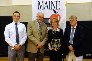 In a surprise all-school assembly Thursday at Skowhegan Area Middle School, longtime MSAD 54 special educator Jennifer Dorman was named the 2015 Maine Teacher of the Year. She is the second special education teacher ever honored with Maine's top award for educator excellence. Pictured here: Skowhegan Area Middle School Principal Zachary Longyear, Maine Department of Education Commissioner Jim Rier, 2015 Maine Teacher of the Year Jennifer Dorman and MSAD 54 Superintendent Brent Colbry.