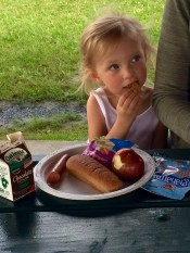 A young girl at the summer food meal site