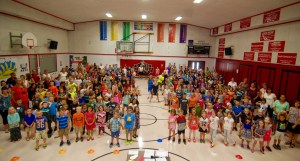 Minot Consolidated School students gather in the school's gymnasium