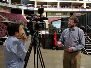 Director of Maine Learning Through Technology discusses micro-credentials to a reporter at ACTEM's annual conference