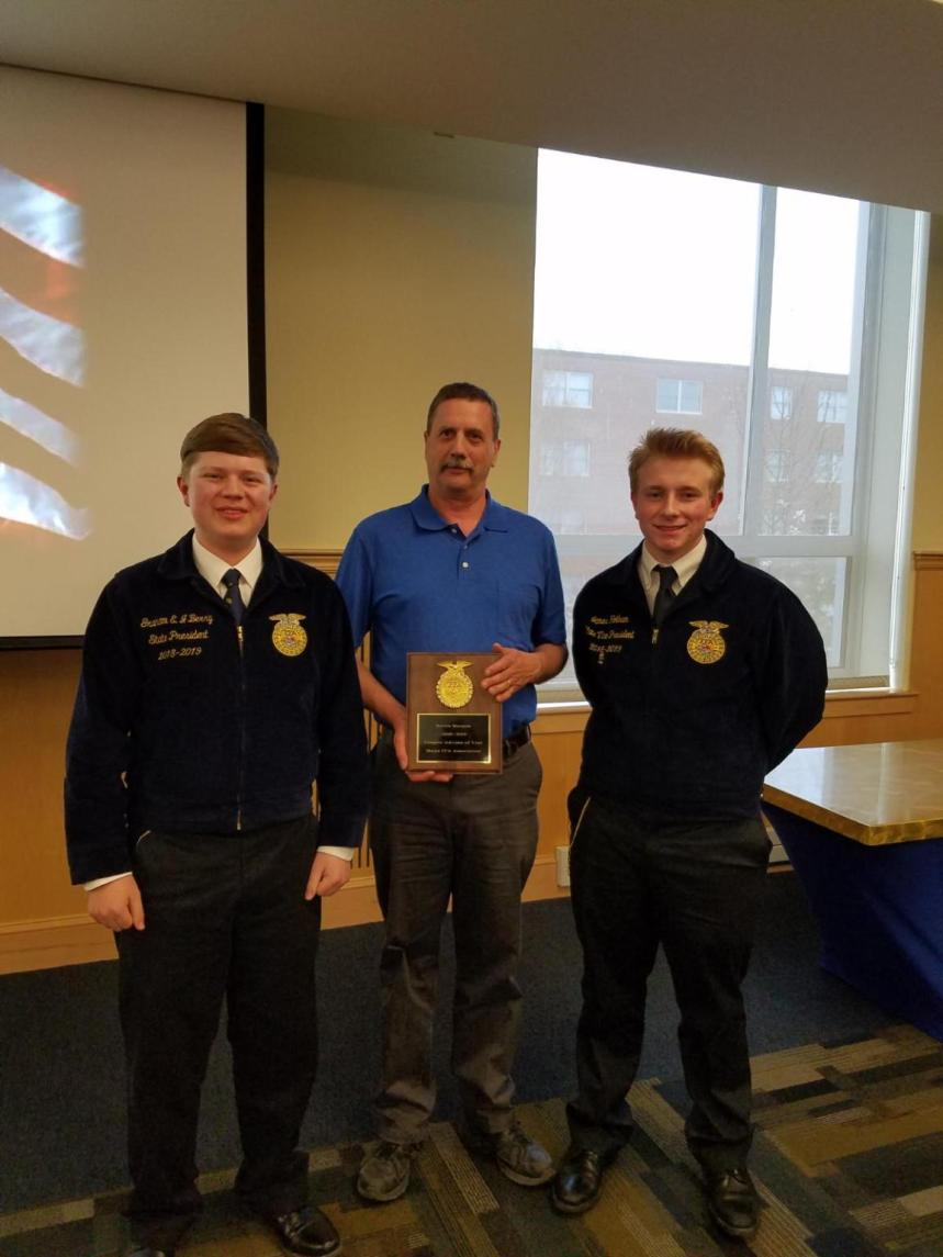 FFA Chapter Advisor of the Year, Kevin Marquis (Easton), next to State FFA President and Vice President.
